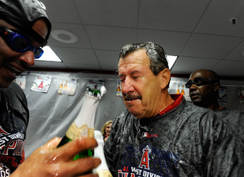 ANAHEIM, CA - SEPTEMBER 28:  Arte Moreno (R) owner of the Los Angeles Angels of Anaheim celebrates with after winning the American League West title in the baseball agme against Texas Rangers at Angel Stadium on September 28, 2009 in Anaheim, California.