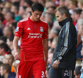 LIVERPOOL, ENGLAND - AUGUST 27:  Dejected Martin Kelly of Liverpool walks off the pitch injured during the Barclays Premier League match between Liverpool and Bolton Wanderers at Anfield on August 27, 2011 in Liverpool, England.  (Photo by Clive Brunskill