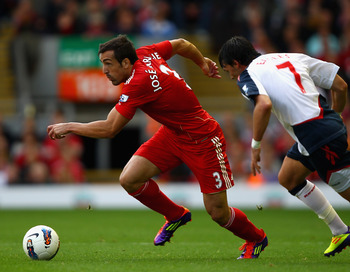LIVERPOOL, ENGLAND - AUGUST 27:  Jose Enrique of Liverpool is closed down by Chris Eagles of Bolton Wanderers during the Barclays Premier League match between Liverpool and Bolton Wanderers at Anfield on August 27, 2011 in Liverpool, England.  (Photo by C
