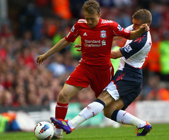 LIVERPOOL, ENGLAND - AUGUST 27:  Leiva Lucas of Liverpool is tackled by Ivan Klasnic of Bolton Wanderers looks on during the Barclays Premier League match between Liverpool and Bolton Wanderers at Anfield on August 27, 2011 in Liverpool, England.  (Photo