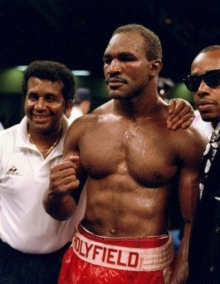 22 Jun 1993: Evander Holyfield (center) looks on prior to his fight against Alex Stewart in Atlantic City, New Jersey.