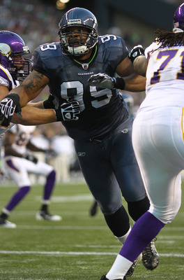 SEATTLE - AUGUST 20:  Defensive tackle Alan Branch #99 of the Seattle Seahawks rushes the ball against the Minnesota Vikings at CenturyLink Field on August 20, 2011 in Seattle, Washington. The Vikings won 20-7. (Photo by Otto Greule Jr/Getty Images)