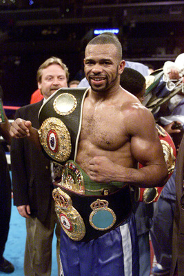 28 Jul 2001:   Roy Jones Jr. celebrates with his belts after defeating Julio Gonzalez at the Staples Center in Los Angeles, California.  Jones retains his belt after twelve rounds. DIGITAL IMAGE. Mandatory Credit: Jed Jacobsohn/Allsport