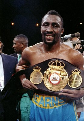 3 Jun 1991:  Thomas Hearns displays a championship belt after his fight against Virgil Hill. Mandatory Credit: Holly Stein  /Allsport
