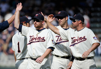 MINNEAPOLIS, MN - AUGUST 28: (L-R) Jason Kubel #16, Joe Mauer #7 and Michael Cuddyer #5 of the Minnesota Twins celebrate a win against the Detroit Tigers on August 28, 2011 at Target Field in Minneapolis, Minnesota. The Twins defeated the Tigers 11-4. (Ph