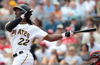 PITTSBURGH - AUGUST 21:  Andrew McCutchen #22 of the Pittsburgh Pirates hits a two run home run against the Cincinnati Reds in the first inning during the game on August 21, 2011 at PNC Park in Pittsburgh, Pennsylvania.  (Photo by Jared Wickerham/Getty Im
