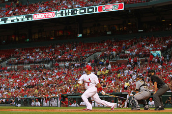 ST. LOUIS, MO - AUGUST 25: Albert Pujols #5 of the St. Louis Cardinals hits an RBI single against the Pittsburgh Pirates at Busch Stadium on August 25, 2011 in St. Louis, Missouri.  (Photo by Dilip Vishwanat/Getty Images)