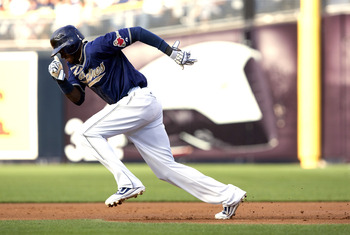 SAN DIEGO, CA - AUGUST 20: Cameron Maybin #24 of the San Diego Padres takes off running for second base in the first inning of the game against the Florida Marlins at Petco Park on August 20, 2011 in San Diego, California. (Photo by Kent C. Horner/Getty I