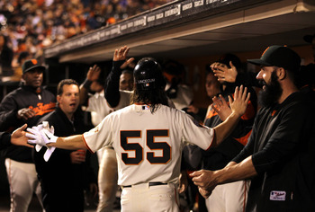 SAN FRANCISCO, CA - AUGUST 24:  Tim Lincecum #55 of the San Francisco Giants is congratulated by teammates in the dugout after the fifth inning in which he hit a RBI single against the San Diego Padres at AT&amp;T Park on August 24, 2011 in San Francisco, Cal