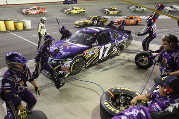 BRISTOL, TN - AUGUST 27:  Matt Kenseth, driver of the #17 Crown Royal Ford, makes a pit stop during the NASCAR Sprint Cup Series Irwin Tools Night Race at Bristol Motor Speedway on August 27, 2011 in Bristol, Tennessee.  (Photo by Tom Whitmore/Getty Image