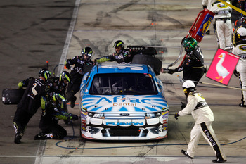 BRISTOL, TN - AUGUST 27:  Carl Edwards, driver of the #99 Aflac Ford, makes a pit stop during the NASCAR Sprint Cup Series Irwin Tools Night Race at Bristol Motor Speedway on August 27, 2011 in Bristol, Tennessee.  (Photo by Chris Graythen/Getty Images)