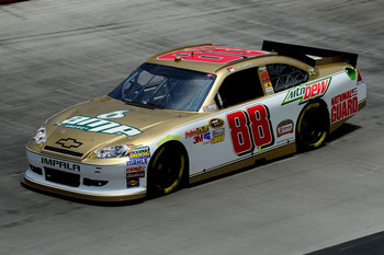 BRISTOL, TN - AUGUST 26:  Dale Earnhardt Jr., driver of the #88 Amp Energy/Bristol 50th Anniversary/National Guard Chevrolet, practices for the NASCAR Sprint Cup Series IRWIN Tools Night Race at Bristol Motor Speedway on August 26, 2011 in Bristol, Tennes