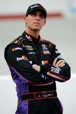 BRISTOL, TN - AUGUST 26:  Denny Hamlin, driver of the #11 FedEx Express Toyota, looks on during qualifying for the NASCAR Sprint Cup Series IRWIN Tools Night Race at Bristol Motor Speedway on August 26, 2011 in Bristol, Tennessee.  (Photo by Jared C. Tilt