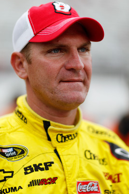 BRISTOL, TN - AUGUST 26:  Clint Bowyer, driver of the #33 Hamburger Helper Chevrolet, looks on during qualifying for the NASCAR Sprint Cup Series IRWIN Tools Night Race at Bristol Motor Speedway on August 26, 2011 in Bristol, Tennessee.  (Photo by Chris G
