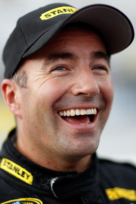 BRISTOL, TN - AUGUST 26:  Marcos Ambrose, driver of the #9 Stanley Ford, looks on during qualifying for the NASCAR Sprint Cup Series IRWIN Tools Night Race at Bristol Motor Speedway on August 26, 2011 in Bristol, Tennessee.  (Photo by Chris Graythen/Getty
