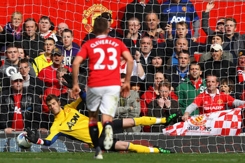 MANCHESTER, ENGLAND - AUGUST 28:  David De Gea of Manchester United saves a penalty kick from Robin van Persie of Arsenal during the Barclays Premier League match between Manchester United and Arsenal at Old Trafford on August 28, 2011 in Manchester, Engl