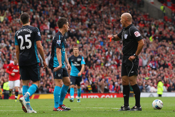 MANCHESTER, ENGLAND - AUGUST 28:  Carl Jenkinson of Arsenal is sent off by referee Howard Webb during the Barclays Premier League match between Manchester United and Arsenal at Old Trafford on August 28, 2011 in Manchester, England.  (Photo by Alex Livese