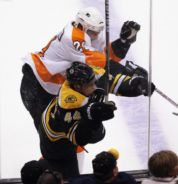 BOSTON, MA - MAY 06: James van Riemsdyk #21 of the Philadelphia Flyers hits Dennis Seidenberg #44 of the Boston Bruins into the glass in Game Four of the Eastern Conference Semifinals during the 2011 NHL Stanley Cup Playoffs at TD Garden on May 6, 2011 in