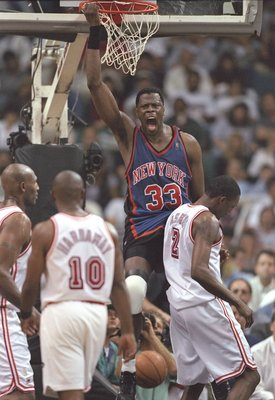 7 May 1997:  Center Patrick Ewing of the New York Knicks slam dunks the ball as guard Tim Hardaway of the Miami Heat watches during a playoff game at the Miami Arena in Miami, Florida.  The Knicks won the game 88-79. Mandatory Credit: Andy Lyons  /Allspor