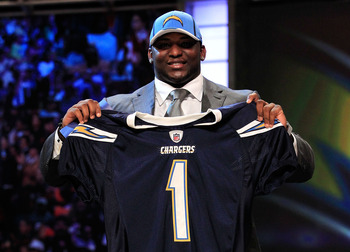 NEW YORK, NY - APRIL 28:  Corey Liuget, #18 overall pick by the San Diego Chargers, holds up a jersey on stage during the 2011 NFL Draft at Radio City Music Hall on April 28, 2011 in New York City.  (Photo by Chris Trotman/Getty Images)