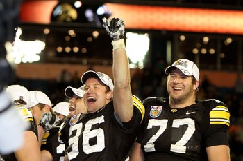 MIAMI GARDENS, FL - JANUARY 05:  (L-R) Trey Stross #86 and Riley Reiff #77 of the Iowa Hawkeyes celebrate after Iowa won 24-14  against the Georgia Tech Yellow Jackets during the FedEx Orange Bowl at Land Shark Stadium on January 5, 2010 in Miami Gardens,
