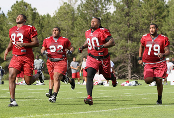 FLAGSTAFF, AZ - JULY 30:  (L-R) Calais Campbell #93, Dan Williams #92, Darnell Dockett #90 and David Carter #79 of the Arizona Cardinals participate in running drills during the team training camp at Northern Arizona University on July 30, 2011 in Flagsta