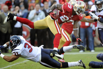 SAN FRANCISCO - AUGUST 27: Chris Culliver #29 of the San Francisco 49ers returning a kick off gets tackled by Shiloh Keo #31 of the Houston Texans during an NFL pre-season football game at Candlestick Park August 27, 2011 in San Francisco, California. The