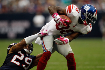 HOUSTON - OCTOBER 10:  Hakeem Nicks #88 of the New York Giants is tackled by Glover Quin #29 of the Houston Texans at Reliant Stadium on October 10, 2010 in Houston, Texas.  The Giants defeated the Texans 34-10.  (Photo by Chris Graythen/Getty Images)
