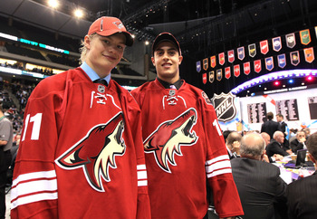ST PAUL, MN - JUNE 25:  (L-R)  51st overall pick Alexander Ruuttu and 56th overall pick Lucas Lessio by the Phoenix Coyotes pose for a group photo on the draft floor during day two of the 2011 NHL Entry Draft at Xcel Energy Center on June 25, 2011 in St P
