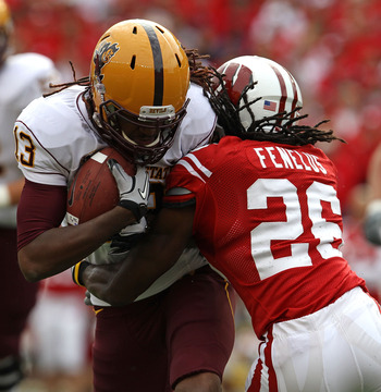 MADISON, WI - SEPTEMBER 18: George Bell #13 of the Arizona State Sun Devils is tackled by Antonio Fenelus #26 of the Wisconsin Badgers at Camp Randall Stadium on September 18, 2010 in Madison, Wisconsin. (Photo by Jonathan Daniel/Getty Images)