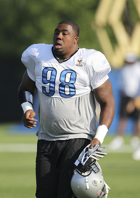 ALLEN PARK, MI - AUGUST 01:  Nick Fairley #98 of the Detroit Lions get ready for the start of the days practice session at the Lions training facility on August 1, 2011 in Allen Park, Michigan.  (Photo by Leon Halip/Getty Images)