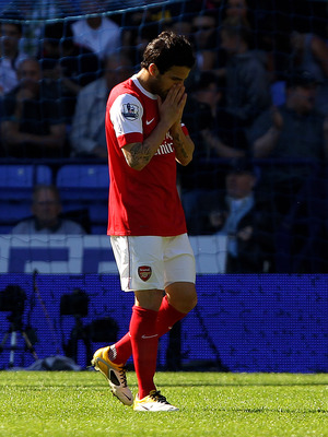 BOLTON, ENGLAND - APRIL 24:  Cesc Fabregas of Arsenal reacts during the Barclays Premier League match between Bolton Wanderers and Arsenal at the Reebok Stadium on April 24, 2011 in Bolton, England.  (Photo by Clive Brunskill/Getty Images)