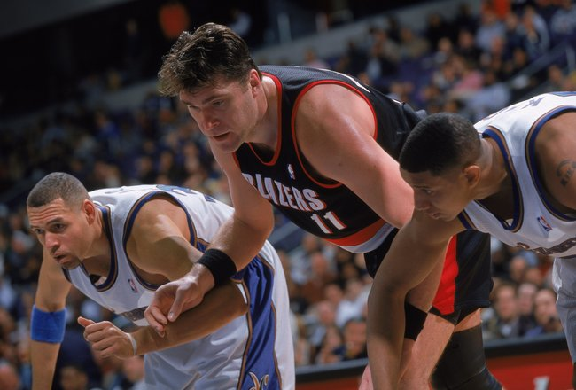 12 Mar 2000: Arvydas Sabonis #11 of the Portland TrailBlazers wait on the key to move for the ball with Aaron Williams #44 of the Washington Wizards at the MCI Center in Wahington, D.C. The Blazers defeated the Wizards 102-86.