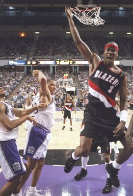 9 Nov 1996:  Forward Cliff Robinson of the Portland Trailblazers slam dunks the ball during a game against the Sacramento Kings at the Arco Arena in Sacramento, California.  The Kings won the game 103-102.   Mandatory Credit: Otto Greule  /Allsport
