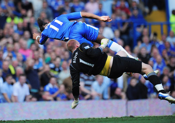 LONDON, ENGLAND - AUGUST 27: Goalkeeper John Ruddy of Norwich City collides with Didier Drogba of Chelsea during the Barclays Premier League match between Chelsea and Norwich City at Stamford Bridge on August 27, 2011 in London, England.  (Photo by Shaun