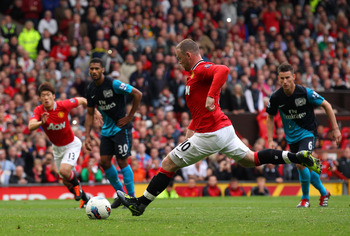 MANCHESTER, ENGLAND - AUGUST 28:  Wayne Rooney of Manchester United scores his third goal from the penalty spot during the Barclays Premier League match between Manchester United and Arsenal at Old Trafford on August 28, 2011 in Manchester, England.  (Pho