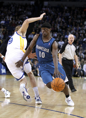 OAKLAND, CA - DECEMBER 14:  Jonny Flynn #10 of the Minnesota Timberwolves dribbles past Lou Amundson #19 of the Golden State Warriors at Oracle Arena on December 14, 2010 in Oakland, California.  NOTE TO USER: User expressly acknowledges and agrees that,