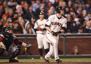SAN FRANCISCO, CA - AUGUST 27: Aubrey Huff #17 of the San Francisco Giants and Humberto Quintero #55 of the Houston Astros watch a ball as it leaves the bat of Aubrey Huff #17 of the San Francisco Giants during a game between the Houston Astros and the Sa