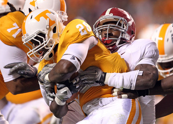 KNOXVILLE, TN - OCTOBER 23:  Tauren Poole #28 of the Tennessee Volunteers runs with the ball dwhile tackled by C.J. Mosley #32 of the Alabama Crimson Tide at Neyland Stadium on October 23, 2010 in Knoxville, Tennessee.  (Photo by Andy Lyons/Getty Images)