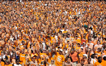 KNOXVILLE, TN - SEPTEMBER 18:  Orange-clad Tennessee Volunteers fans sing along with 'Rocky Top' during a game against the Florida Gators at Neyland Stadium on September 18, 2010 in Knoxville, Tennessee. Florida won 31-17.  (Photo by Grant Halverson/Getty