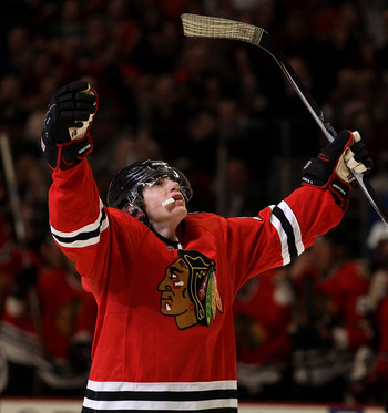 CHICAGO, IL - MARCH 14: Patrick Kane #88 of the Chicago Blackhawks celebrates the one hundredth goal of his career in the 2nd period against the San Jose Sharks at the United Center on March 14, 2011 in Chicago, Illinois. (Photo by Jonathan Daniel/Getty I