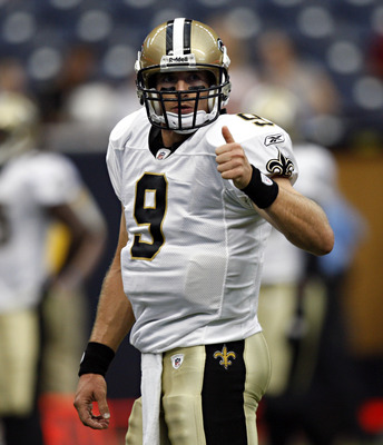HOUSTON - AUGUST 20:  Quarterback Drew Brees #9 of the New Orleans Sainst looks to the bench during a pre-season football game against the Houston Texans at Reliant Stadium on August 20, 2011 in Houston, Texas.  (Photo by Bob Levey/Getty Images)