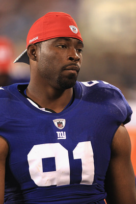 CHARLOTTE, NC - AUGUST 13:  Justin Tuck #91 of the New York Giants against the Carolina Panthers during their preseason game at Bank of America Stadium on August 13, 2011 in Charlotte, North Carolina.  (Photo by Streeter Lecka/Getty Images)