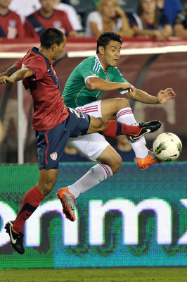 PHILADELPHIA, PA - AUGUST 10: Pablo Barrera #7 of Mexico and Edgar Castillo #2 of the United States jump to kick the ball at Lincoln Financial Field on August 10, 2011 in Philadelphia, Pennsylvania. (Photo by Drew Hallowell/Getty Images)