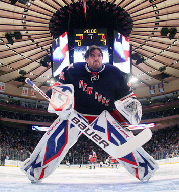 NEW YORK, NY - APRIL 04:  Henrik Lundqvist #30 of the New York Rangers gets set for the opening faceoff against the Boston Bruins at Madison Square Garden on April 4, 2011 in New York City. The Rangers defeated the Bruins 5-3.  (Photo by Bruce Bennett/Get