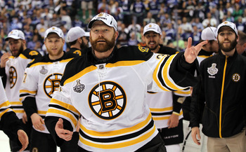 VANCOUVER, BC - JUNE 15:  Tim Thomas #30 of the Boston Bruins celebrates winning the Stanley Cup after defeating the Vancouver Canucks in Game Seven of the 2011 NHL Stanley Cup Final at Rogers Arena on June 15, 2011 in Vancouver, British Columbia, Canada.