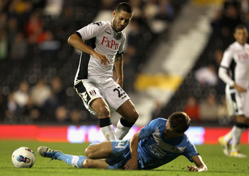 LONDON, ENGLAND - AUGUST 18:  Clint Dempsey of Fulham is tackled by Serhiy Kravchenko of FC Dnipro during the UEFA Europa League Play-Off round qualifying first leg match between Fulham and FC Dnipro Dnipropetrovsk at Craven Cottage on August 18, 2011 in
