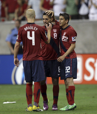 HOUSTON - JUNE 22:  Clint Dempsey #8 of the U.S.A. is congratulated by Michael Bradley #4 and Alejandro Bedoya #22 at the final whistle at Reliant Stadium on June 22, 2011 in Houston, Texas. Dempsey's goal in the seventy seventh minute was the game winner
