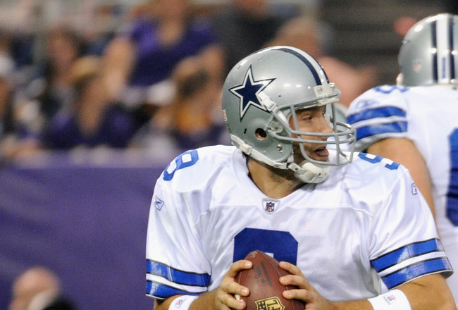 MINNEAPOLIS, MN - AUGUST 27: Tony Romo #9 of the Dallas Cowboys carries the ball in the first half against the Minnesota Vikings on August 27, 2011 at Hubert H. Humphrey Metrodome in Minneapolis, Minnesota. (Photo by Hannah Foslien/Getty Images)