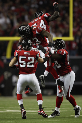 ATLANTA, GA - JANUARY 15:  Coy Wire #52, Mike Peterson #53, Stephen Nicholas #54 and Curtis Lofton #50 of the Atlanta Falcons celebrate a defensive play against the Green Bay Packers during their 2011 NFC divisional playoff game at Georgia Dome on January